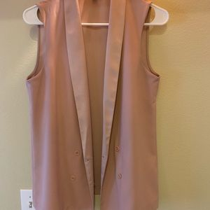 Pink sleeveless blazer